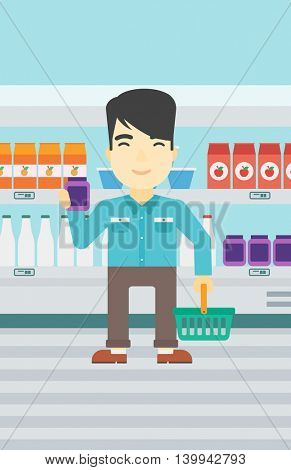 An asian young man holding shopping basket in one hand and a milk product in the other. Male customer shopping at supermarket with basket. Vector flat design illustration. Vertical layout.