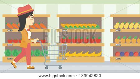 An asian young woman pushing empty supermarket cart. Woman shopping at supermarket with cart. Woman walking with trolley on aisle at supermarket. Vector flat design illustration. Horizontal layout.