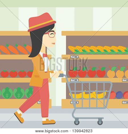 An asian young woman pushing empty supermarket cart. Woman shopping at supermarket with cart. Woman walking with trolley on aisle at supermarket. Vector flat design illustration. Square layout.