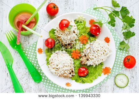 Steamed meat and rice hedgehogs with vegetables fun and healthy idea for children dinner top view