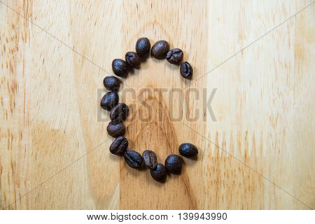 Alphabet 'c' Make From Coffee Bean On Wood Background