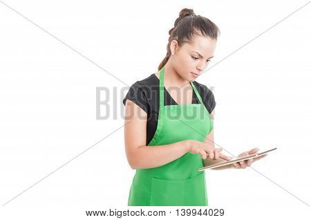 Young Supermarket Worker Searching Something On Tablet