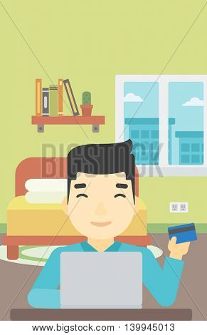 An asian man holding a credit card and using laptop for online shopping. Young man shopping online at home. Man making online payment. Vector flat design illustration. Vertical layout.