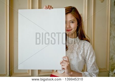 Portrait Of A Beautiful Asia Woman Holding A Blank Board