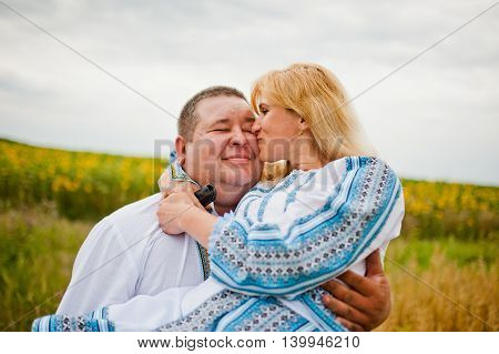 Happy husband and wife. Kissing couple outdoor