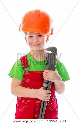Little builder in red coveralls and helmet with wrench, isolated on white