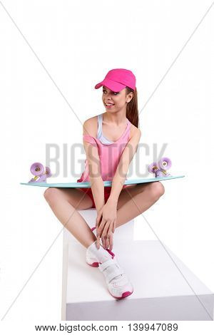 woman posing with skateboard isolated on a white background