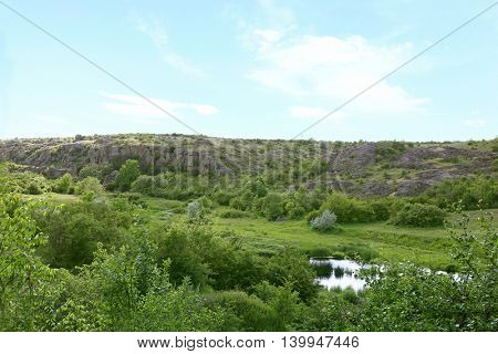 View on the wild nature with river and hills