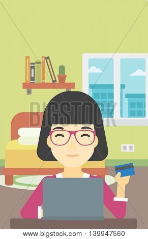 An asian woman holding a credit card and using laptop for online shopping. Woman shopping online at home. Woman making online payment. Vector flat design illustration. Vertical layout.
