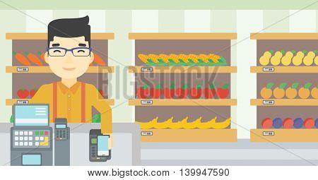 An asian young man paying wireless with his smartphone at the supermarket checkout . Male customer making payment for purchase with smartphone. Vector flat design illustration. Horizontal layout.