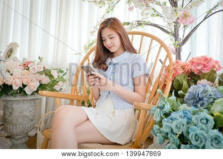 Girls chat messages via mobile phone .