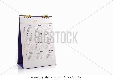 White paper desk spiral calendar 2017 on white background.