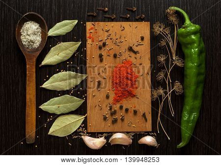 A set of spices and herbs on black board