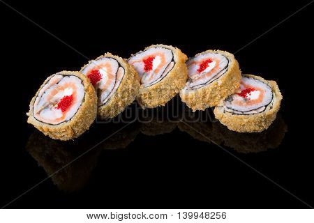 Japanese rolls on black background isolated with reflections
