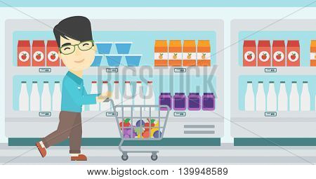 An asian young man pushing a supermarket cart with some goods in it. Customer shopping at supermarket with cart. Vector flat design illustration. Horizontal layout.