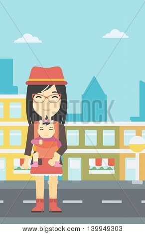 An asian mother carrying daughter in sling. Mother with baby in sling walking in the city street. Young mother carrying a newborn in sling. Vector flat design illustration. Vertical layout.