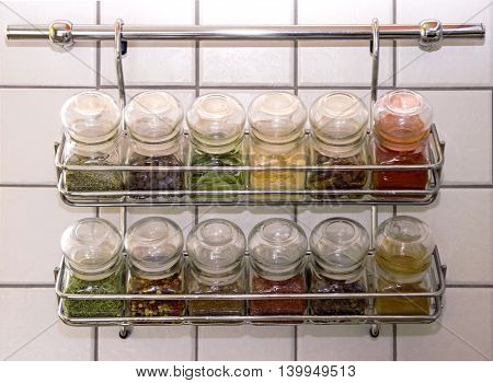 Close up of jars of spices in hanging shelf