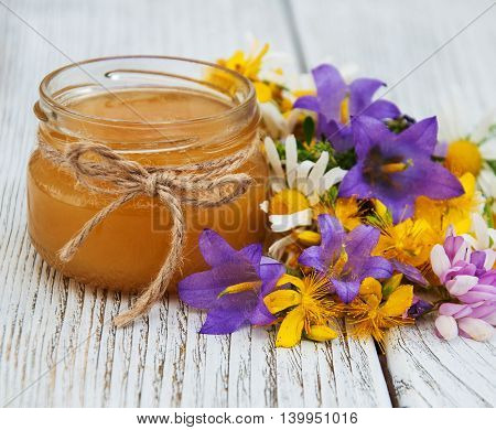 Jar Of Honey With Wildflowers
