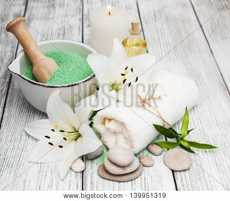 Spa concept with white lily on a wooden table