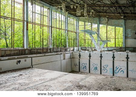 abandoned swimming pool in Sports Palace gym in Pripyat. Chernobyl zone