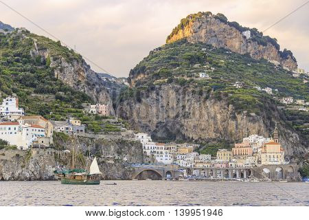 Italy seascape:Amalfi Coast (Costiera Amalfitana).View of Atrani marina from the sea at sundown.