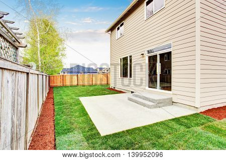 House Fenced Back Yard Exterior  With Well Kept Lawn