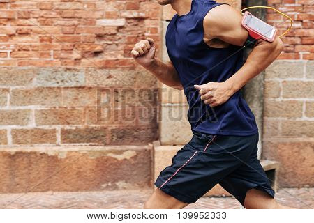Cropped image of man getting ready to marathon