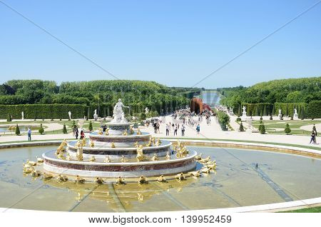 VERSAILLES PARIS FRANCE 6 JUNE 2015: Latona fountain at Versailles Palace with gardens in background