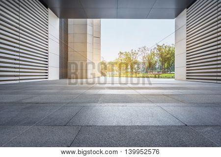 Empty brick floor with modern building in Shanghai