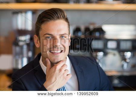Close-up of smart businessman in café