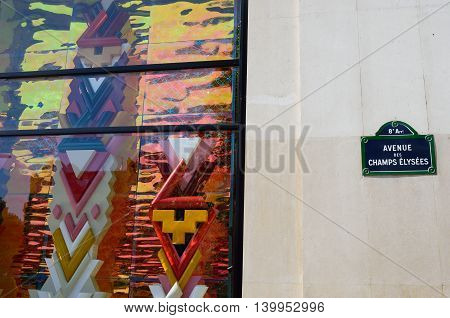 PARIS FRANCE 7 JUNE 2015: Detail of Louis Vuitton shopfront Champs Elysees