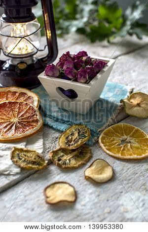 Dried oranges, kiwi and apples, dry flowers