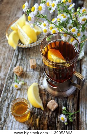 Summer composition: glass of tea with lemon and honey