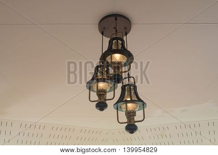 Classic hanging lamp on the ceiling, background,