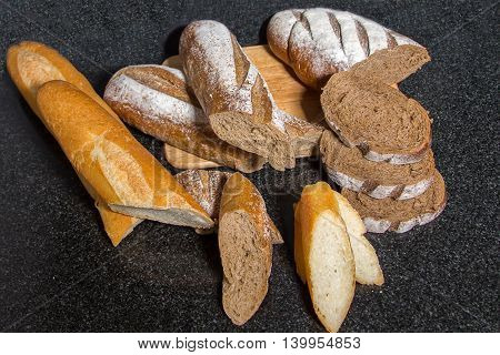 Fresh fragrant bread on the table. Freshly baked baguette bread on wooden cutting board