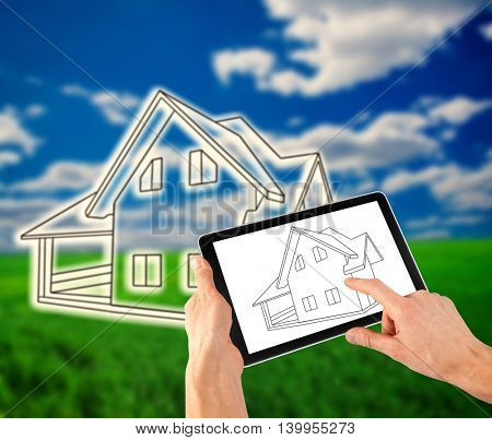man drawing a plan of his house on the tablet like ipade
