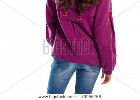 Woman wears jeans and coat. Blue pants and purple outerwear. Garment made of quality fleece. Model demonstrates new outfit.