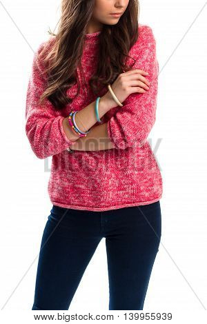 Girl in pink sweatshirt. Dark navy pants and bracelets. Buy stylish clothes for spring. Collection of youth apparel.