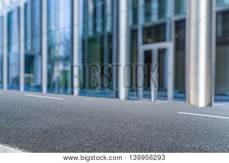 clean asphalt road front of office building,shanghai china.