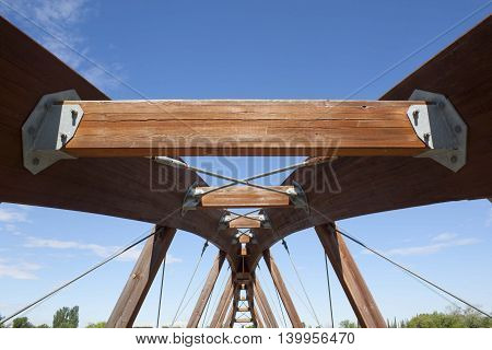 structure of a wooden bridge in a cloudless sky