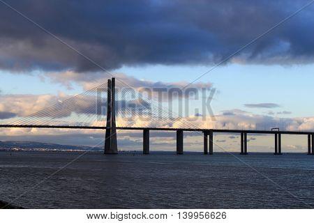 Vasco Da Gama Bridge In A Cloudy Night In Lisbon, Portugal