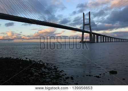 Vasco Da Gama Bridge Behind Some Stones, Lisbon, Portugal