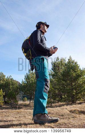 Mountaineer Between Pine Trees Hiking In Huesca, Spain
