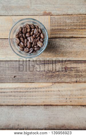 coffee bean in a glass on a wooden table