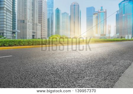 clean asphalt road with city skyline background,china.