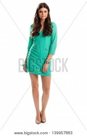 Girl in turquoise dress. Heel shoes of beige color. Evening outfit with glossy footwear. Trendy wrist watch.