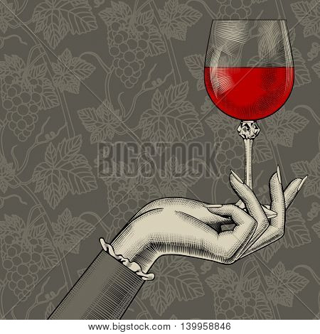 Women's hand with a wine glass on grapes background. Vintage stylized drawing. Contains the Clipping Path
