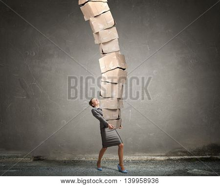 Woman carrying carton boxes . Mixed media