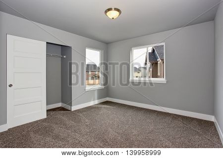 Small Basement Room Interior With Grey Walls And White Trim.