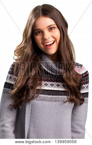 Smiling woman on white background. Gray pullover with pattern. Give me a smile. Find a reason to rejoice.
